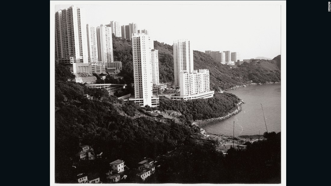 "A photo showing Hong Kong's Sandy Bay. Curator Jeffrey Dietsch said that during the Hong Kong leg of the trip Warhol took his photos quickly: ""He didn't stop to say 'hold on'... it was an extension of the way he perceived the world."""