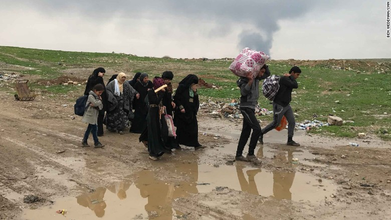 "With the little they could carry west Mosul residents are streaming out of the city. ""It's a catastrophe,"" one young man told the CNN crew."
