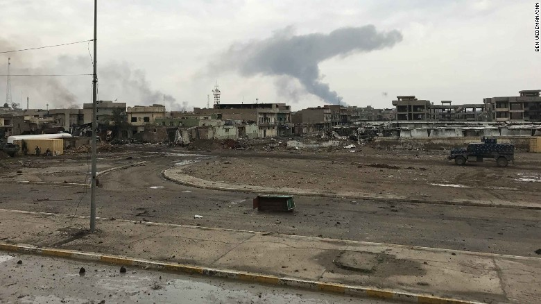 Smoke rises over west Mosul's old city. Iraqi forces are fighting street-by-street, house-by-house. The Iraqi government doesn't publish casualty figures but the CNN crew saw many ambulances rushing toward the battle zone.