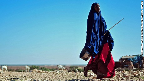 A woman walks through a parched area in northeastern Somalia earlier this year. Rape is on the rise there.