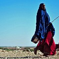 Somalian Woman walks through dryland
