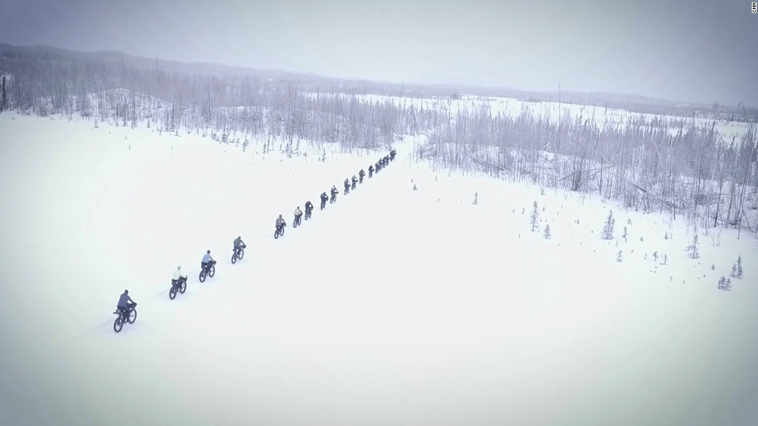 Racers begin down an icy road that turns into a trail that becomes wilderness within the first mile. Soon after that, the pack starts to thin out as bikers pull ahead.<br />