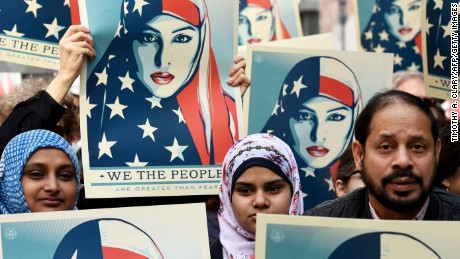 Protesters march in New York's Times Square in solidarity with American Muslims and against the travel ban ordered by US President Donald Trump on February 19, 2017.  / AFP / TIMOTHY A. CLARY        (Photo credit should read TIMOTHY A. CLARY/AFP/Getty Images)