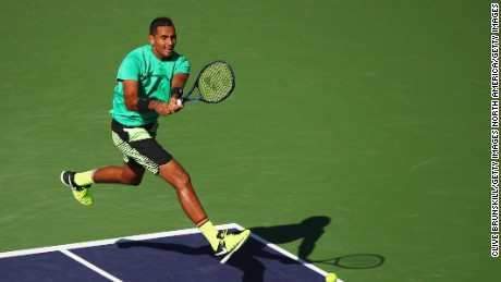 INDIAN WELLS, CA - MARCH 15:  Nick Kyrgios of Australia plays a backhand during his straight set victory against Novak Djokovic of Serbia in their fourth round match during day ten of the BNP Paribas Open at Indian Wells Tennis Garden on March 15, 2017 in Indian Wells, California.  (Photo by Clive Brunskill/Getty Images)