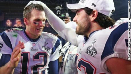 Nate Ebner (R) congratulates Tom Brady after the New England Patriots' 2015 Super Bowl win.