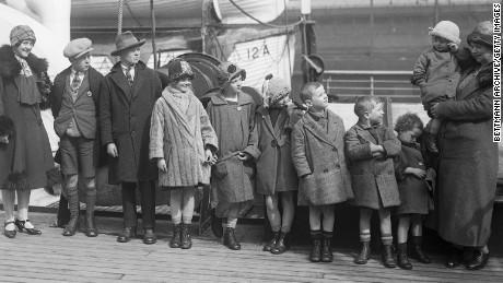 (Original Caption) 3/16/1926-New York-Photo shows Mrs. Thomas McKessy, of Limerick, Ireland, upon her arrival in New York on the SS Aurania. She is joining her husband, who came over last September, with 10 of her family of 21 children. Pictured (L-R) are Johanna, John, Dennis, Lizzie, Katherine, Bridget, Eugene, Donald, Ita, and Mrs. McKessy holding Cecilia the youngest in her arms. Of her 21 children, 4 are here already, 10 just arrived, 5 died and two are married in Ireland.