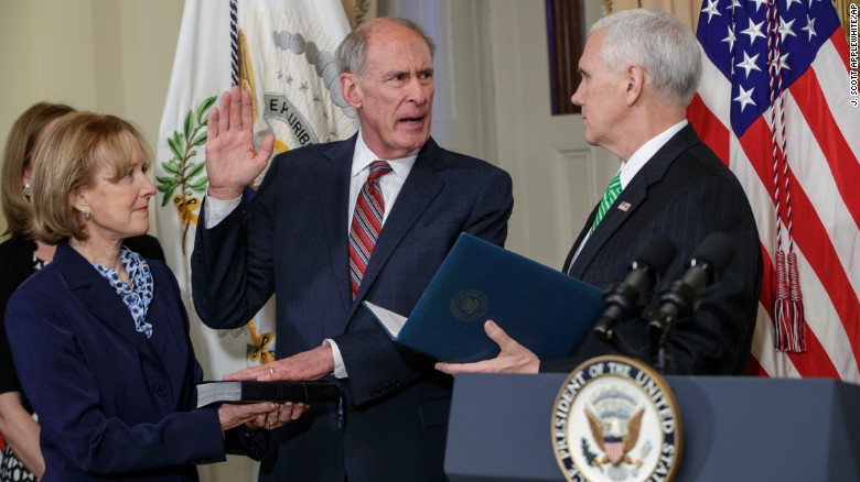 Vice President Mike Pence, right, administers the oath of office to Dan Coats, the new director of national intelligence, on Thursday, March 16. Coats was accompanied by his wife, Marsha. He was confirmed by the Senate the day before.