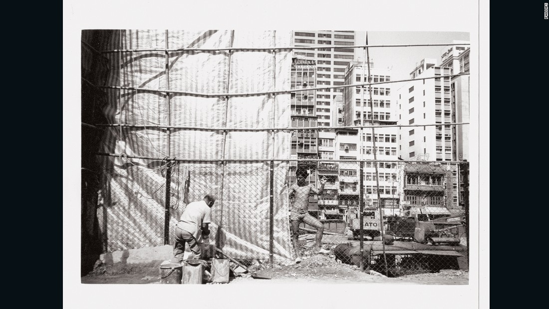 Construction work in Hong Kong.   Warhol's personal collection of photos from the trip may fetch up to $1.1 million in total by Phillips auction house.