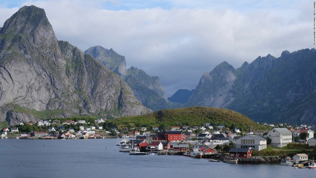 <strong>1. Norway. </strong>This Scandinavian country filled with hikers, fjord-explorers and coffee drinkers vaulted from fourth place to first place to become the world's happiest country. The Lofoten Islands, shown here, are well known for their jagged mountains and red cabins.