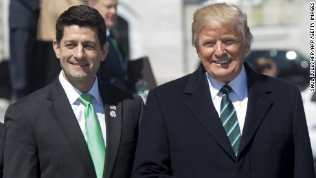 US President Donald Trump waves alongside Speaker of the House Paul Ryan (L) as Trump leaves the Friends of Ireland Luncheon for the visit of Taoiseach of Ireland Enda Kenny at the US Capitol in Washington, DC, March 16, 2017. / AFP PHOTO / SAUL LOEB