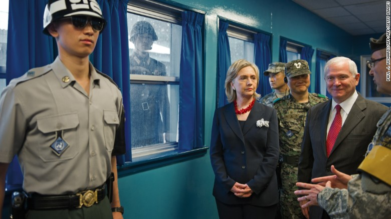 A North Korean soldier looks on as US Secretary of State Hillary Clinton visits the DMZ in 2010.