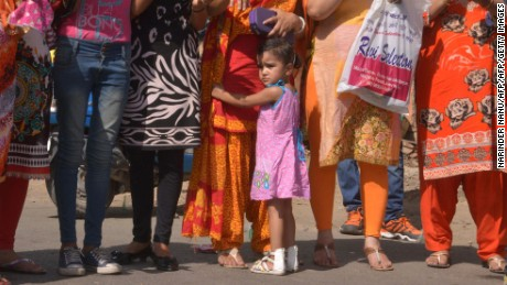 An Indian child joins members of the Punjab Parents Association(PPA) as they stage a protest a outside school in Amritsar on May 25, 2016, against the alleged disproportionate increases of school fees and admission charges in privately run schools in the northern Indian state of Punjab. / AFP / NARINDER NANU        (Photo credit should read NARINDER NANU/AFP/Getty Images)