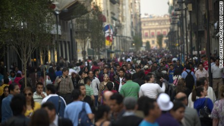 People walk in a crowded street of Mexico City, on November 4, 2011. The United Nations estimates that the world population reached 7 billion on October 31, 2011.     AFP PHOTO/Yuri CORTEZ (Photo credit should read YURI CORTEZ/AFP/Getty Images)