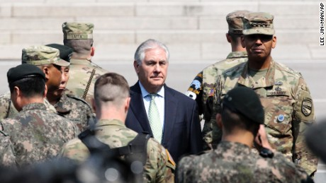 U.S. Secretary of State Rex Tillerson, center, visits with U.S. Gen. Vincent K. Brooks, commander of the United Nations Command, Combined Forces Command and United States Forces Korea, right, at the border village of Panmunjom, which has separated the two Koreas since the Korean War, South Korea, Friday, March 17, 2017. (AP Photo/Lee Jin-man, Pool)