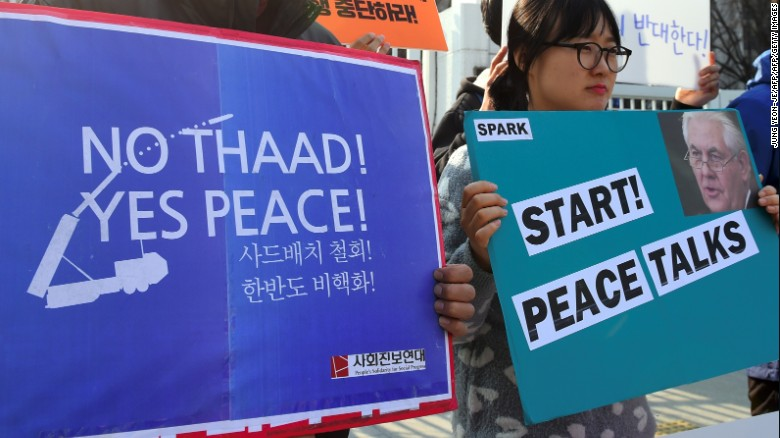 Anti-war activists protest Tillerson in Seoul.