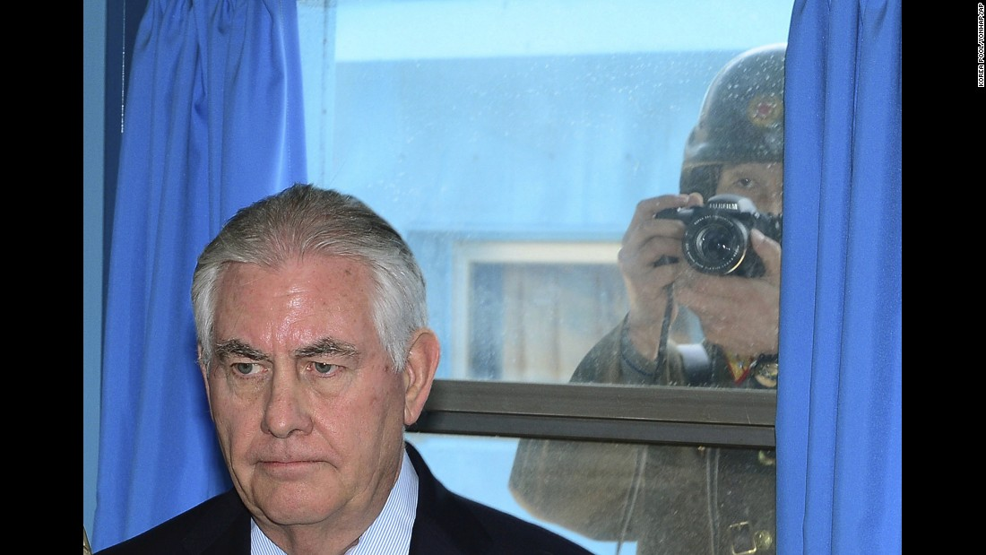 "A North Korean soldier tries to take a photograph through a window as US Secretary of State Rex Tillerson visits a UN meeting room at the border village of Panmunjom on Friday, March 17. <a href=""http://www.cnn.com/2017/03/17/politics/tillerson-south-korea-dmz/"" target=""_blank"">Tillerson visited the world's most heavily armed border,</a> greeting US soldiers near the tense buffer zone between North and South Korea."
