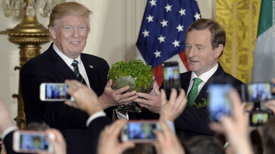 Trump accepts a bowl of shamrocks from Irish Prime Minister Enda Kenny on Thursday, March 16, a day before St. Patrick's Day.