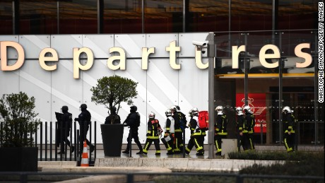 French firefighters and RAID police unit officers secure Paris' Orly airport on March 18, 2017 following the shooting of a man by French security forces. Security forces at Paris' Orly airport shot dead a man who took a weapon from a soldier, the interior ministry said.