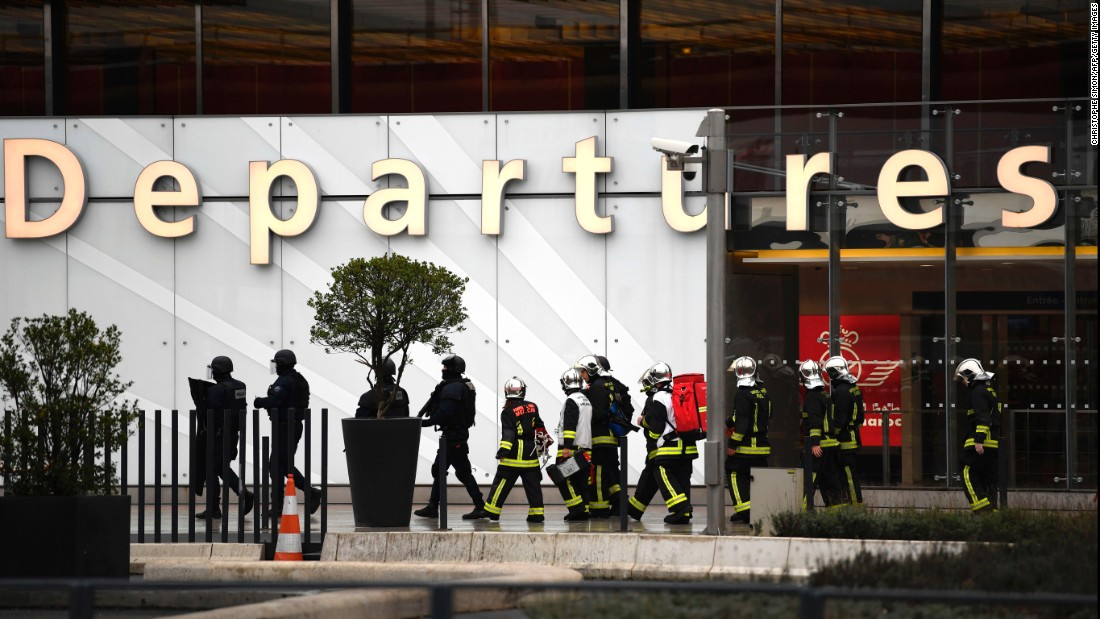 French firefighters and RAID police unit officers secure Paris' Orly airport.