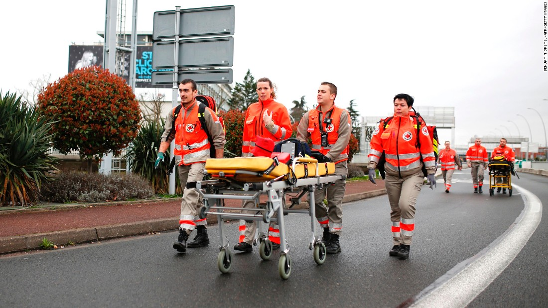 French Red Cross workers arrive at Paris' Orly airport.