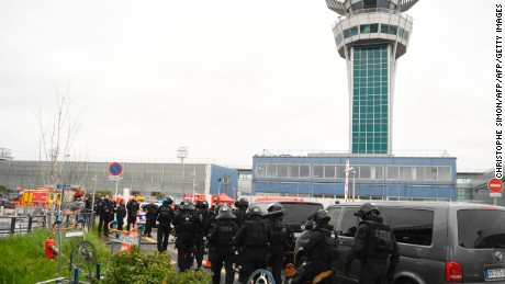 French police secure the area at Paris' Orly airport on March 18, 2017 following the shooting of a man by French security forces.