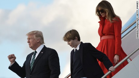 TOPSHOT - US President Donald Trump, son Barron and wife Melania step off Air Force One upon arrival at Palm Beach International Airport in West Palm Beach, Florida on March 17, 2017.