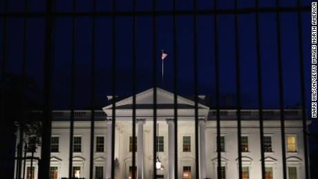 A tall security fence stands in front of the White House on this November 4, 2014 file photoin Washington, DC. Today