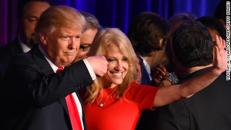 Republican presidential candidate Donald Trump falnked by campaign manager Kellyanne Conway waves to supporters following an address during election night at the New York Hilton Midtown in New York on November 9, 2016.  Trump won the US presidency. / AFP / Timothy A. CLARY        (Photo credit should read TIMOTHY A. CLARY/AFP/Getty Images)