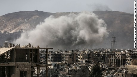 Smoke billows following a reported air strike in the rebel-held parts of the Jobar district, on the eastern outskirts of the Syrian capital Damascus, on March 19, 2017. Heavy clashes rocked eastern districts of Damscus as rebels and jihadists tried to fight their way into the city centre in a surprise assault on government forces. / AFP PHOTO / AMER ALMOHIBANY        (Photo credit should read AMER ALMOHIBANY/AFP/Getty Images)