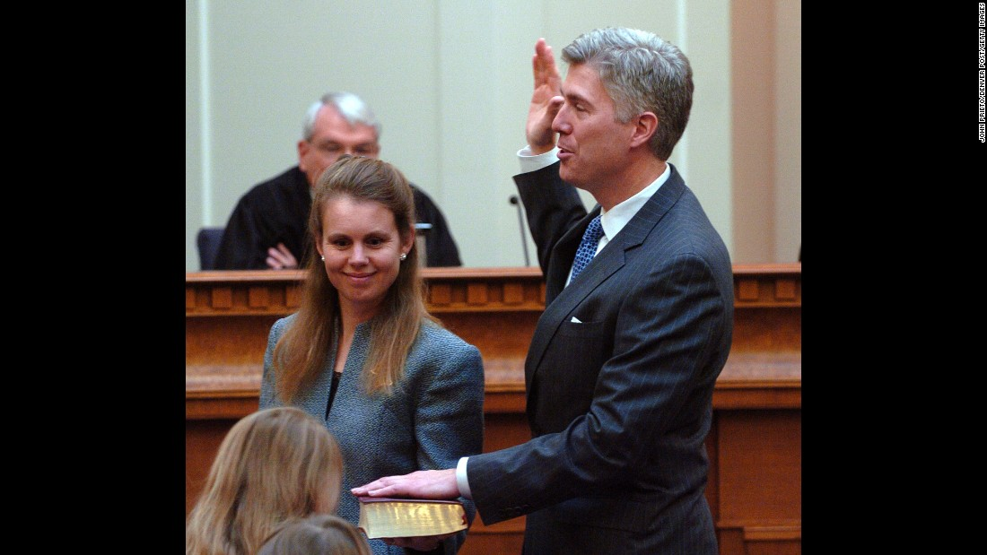 Gorsuch is sworn in as a member of the United States Court of Appeals for the 10th Circuit on November 20, 2006. His wife is holding the Bible.