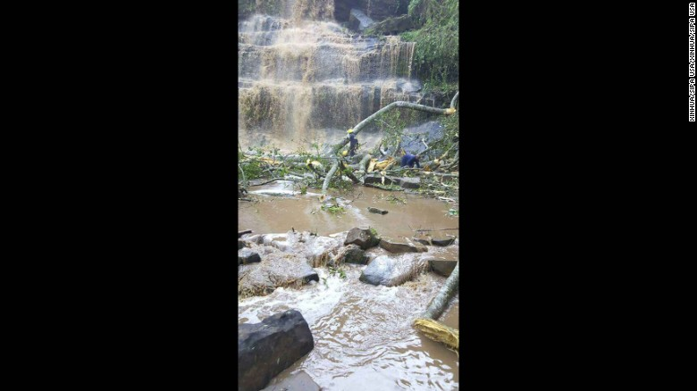Rescuers search for survivors trapped underwater after a tree fell at Kintampo waterfall in Ghana on March 19, 2017.