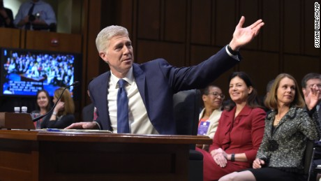 Supreme Court Justice nominee Neil Gorsuch recognized family members in the audience as he arrives on Capitol Hill in Washington on March 20, 2017, for his confirmation hearing before the Senate Judiciary Committee.