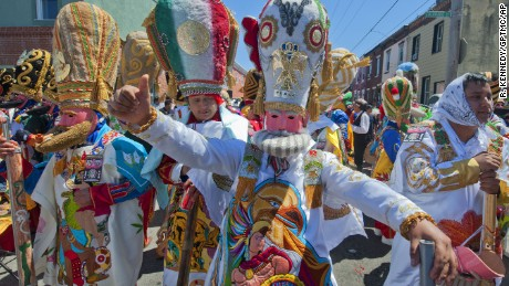 Marchers in Philadelphia's El Carnaval de Puebla dance during the city's 2013 celebration.