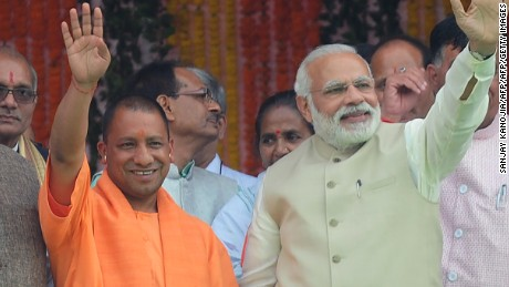 Chief Minister of Uttar Pradesh state Yogi Adityanath (C), Indian Prime Minister Narendra Modi (R) and Bharatiya Janata Party (BJP) president Amit Shah attend Adityanath's swearing-in ceremony as the Uttar Pradesh chief minister in Lucknow on March 19, 2017. Prime Minister Narendra Modi's right-wing party on March 18 picked a controversial firebrand leader to head India's most populous state, where it won a landslide victory last week. After an hours-long meeting with local BJP legislators, senior party leader M. Venkaiah Naidu announced 44-year-old Yogi Adityanath as Uttar Pradesh's next chief minister.  / AFP PHOTO / SANJAY KANOJIA        (Photo credit should read SANJAY KANOJIA/AFP/Getty Images)