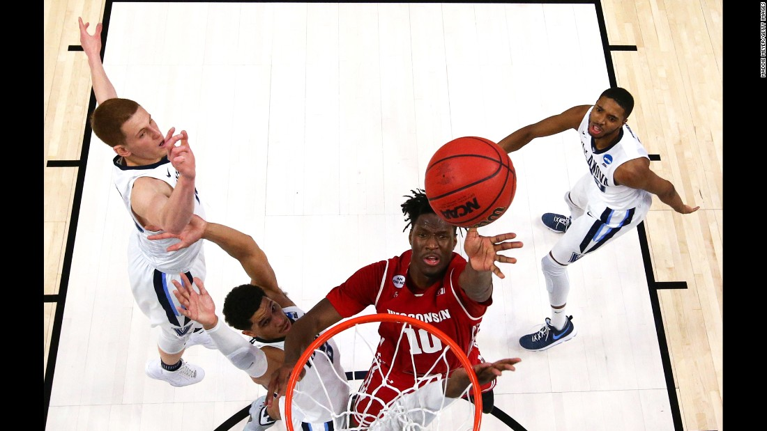 "Wisconsin forward Nigel Hayes takes a shot against Villanova during an NCAA Tournament game on Saturday, March 18. Hayes later scored <a href=""http://bleacherreport.com/articles/2698760-nigel-hayes-tosses-game-winning-layup-vs-villanova"" target=""_blank"">the game-winning basket</a> to upset the defending champions and advance to the Sweet Sixteen. Villanova was a No. 1 seed; Wisconsin was an 8."