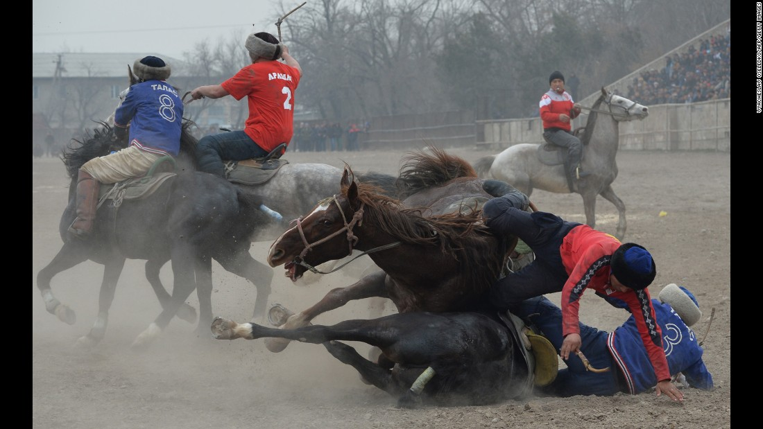 Horsemen play buzkashi during Persian New Year celebrations in Bishkek, Kyrgyzstan, on Thursday, March 16. In buzkashi, players compete to place a goat carcass into a goal circle.