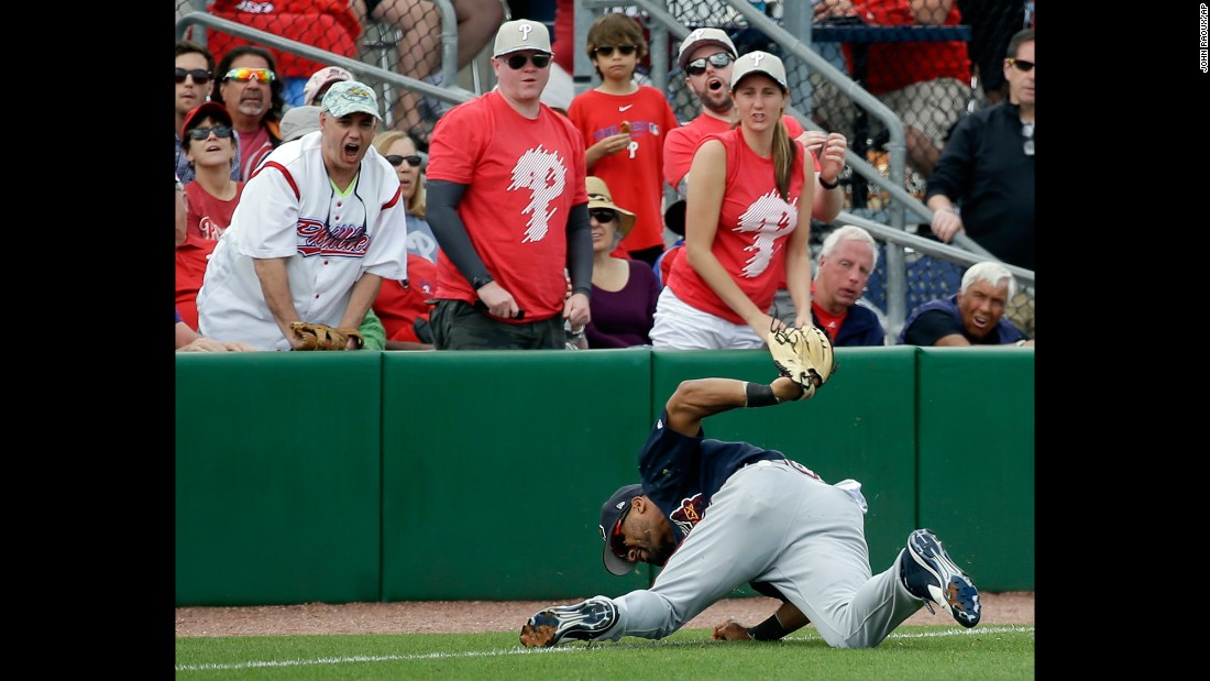 Atlanta outfielder Micah Johnson makes a diving catch -- much to the dismay of Philadelphia fans -- during a spring-training game in Clearwater, Florida, on Tuesday, March 14.