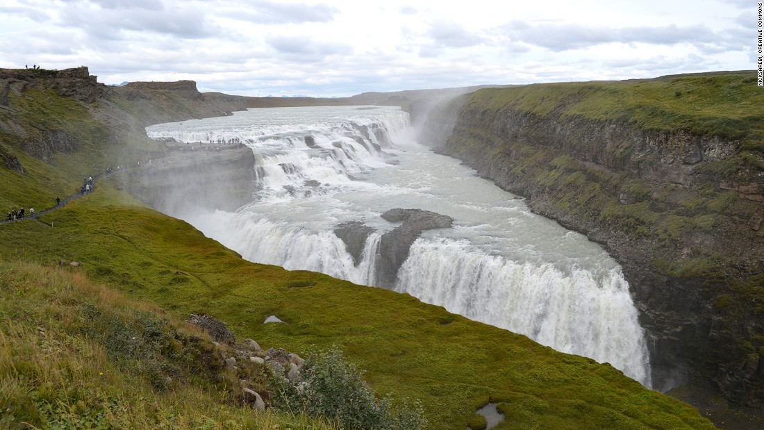 <strong>Gullfoss: </strong>The river Hvítá plunges into a deep gorge over two steps, forming the Gullfoss (Golden Falls). On sunny days, the waterfall looks truly golden.