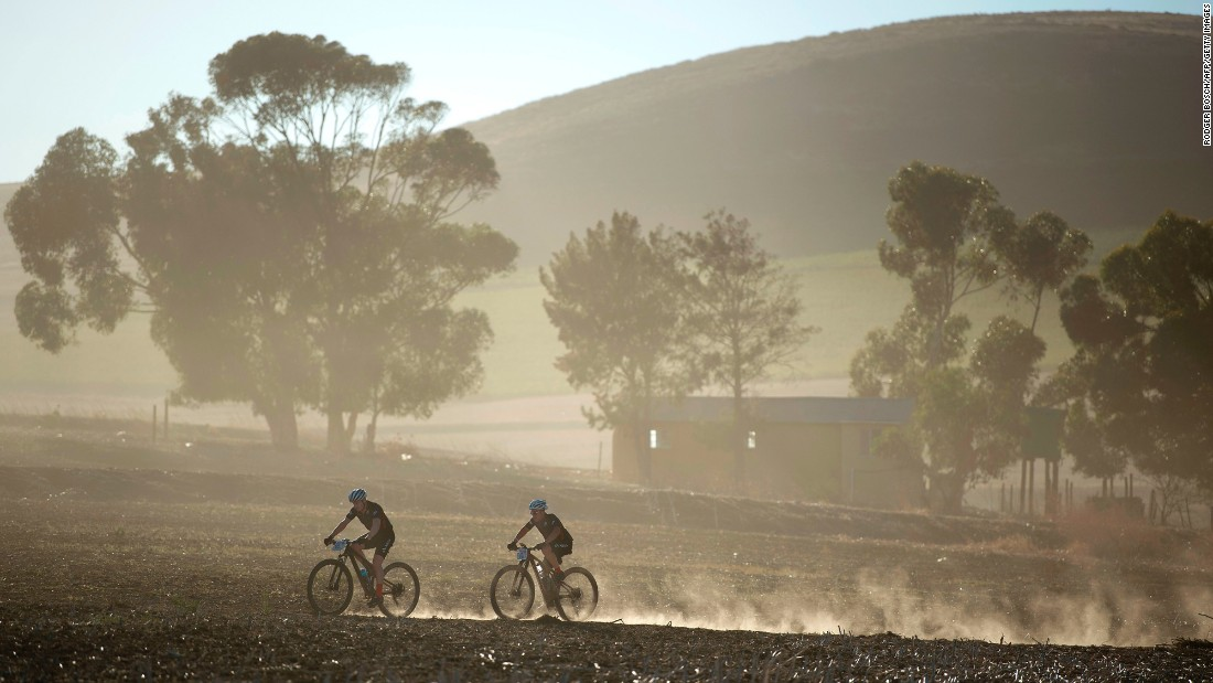 "Cyclists ride through wheat fields in Grabouw, South Africa, during the prologue stage of the Cape Epic race on Sunday, March 19. <a href=""http://www.cnn.com/2017/03/14/sport/gallery/what-a-shot-sports-0314/index.html"" target=""_blank"">See 25 amazing sports photos from last week</a>"