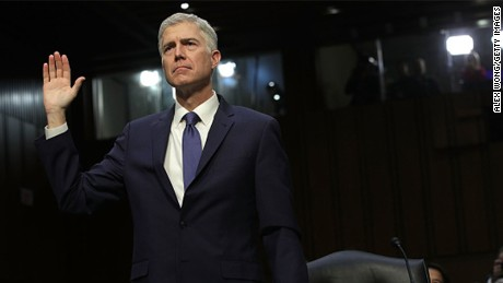 WASHINGTON, DC - MARCH 20: Judge Neil Gorsuch is sworn in during the first day of his Supreme Court confirmation hearing before the Senate Judiciary Committee in the Hart Senate Office Building on Capitol Hill March 20, 2017 in Washington, DC. Gorsuch was nominated by President Donald Trump to fill the vacancy left on the court by the February 2016 death of Associate Justice Antonin Scalia.