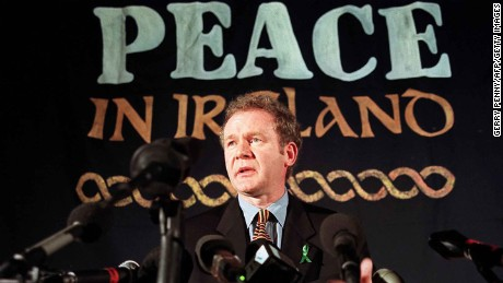 London, UNITED KINGDOM:  (FILES) Sinn Fein chief negotiator Martin McGuinness answering journalists' question during a press conference in London, 26 February 1998. Sinn Fein, the political wing of the Irish Republican Army (IRA), had asked for a meeting with British Prime Minister Tony Blair after being excluded from the all party peace process talks.The British and Irish governments welcomed 04 October 2006 a report that the Irish Republican Army (IRA) has eschewed terrorism, saying it paves the way for a final political settlement in Northern Ireland. Under the 1998 Good Friday Agreement aimed at ending decades of troubles in the British-ruled province on the island of Ireland, a power-sharing self-rule assembly was set up in Stormont castle in Belfast. But the assembly was suspended in 2002 following allegations of an IRA spy ring operating at the Stormont parliamentary buildings, and the province has been under direct rule from London ever since.                          AFP     PHOTO     GERRY PENNY/FILES   (Photo credit should read GERRY PENNY/AFP/Getty Images)