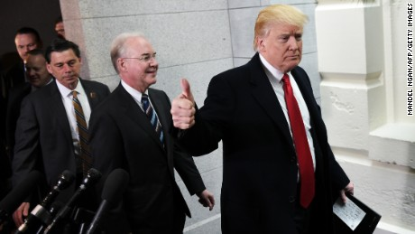 US President Donald Trump and Health and Human Services Secretary Tom Price (L) arrives at the US Capitol to meet with the Republican House Conference on March 12, 2017. / AFP PHOTO / Mandel Ngan        (Photo credit should read MANDEL NGAN/AFP/Getty Images)