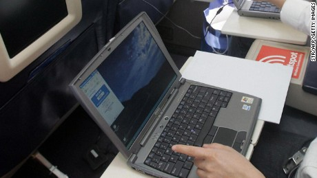 "BEIJING, CHINA:  Guests try out the wireless connection to the Internet on their laptops onboard US aerospace giant Boeing's latest aircraft ""Connexion"", which allows passengers to connect on the Internet wireless while flying, at the Beijing Capital airport 21 September 2005.  Boeing claimed that China will need more than 2,600 new planes worth 213 billion USD over the next 20 years, quadrupling its fleet to become the world's second largest aviation market.           AFP PHOTO  (Photo credit should read STR/AFP/Getty Images)"