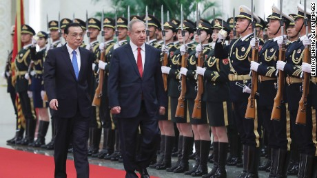 Chinese Premier Li Keqiang (left) accompanies Israeli Prime Minister Benjamin Netanyahu inside the Great Hall of the People in Beijing on March 20, 2017.