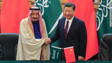 Chinese President Xi (R) shake hands with Saudi Arabia's King Salman in the Great Hall of the People on March 16, 2017 in Beijing.