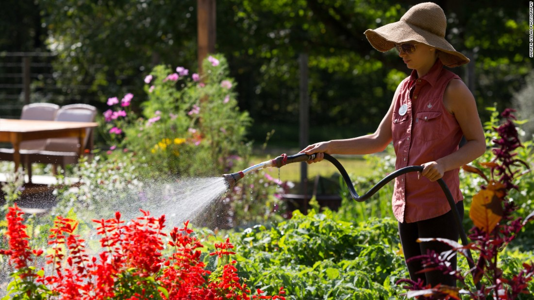 <strong>Farm-to-table hotels. </strong>These resorts don't just feed their customers locally grown food. They actually grow and raise some of the food at their own farms, most of which are on site. The Lodge at Woodloch in Pennsylvania has a gardening team, including Jessica Castellano, seen here watering the farm's flowers.