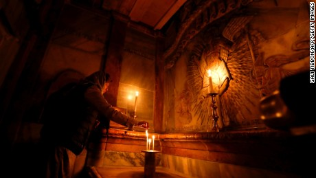 A worshipper prays inside the Edicule surrounding Jesus' tomb.