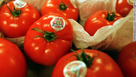 Organic tomatoes are shown July 10, 2001 at Green Street Natural Foods in Melrose, MA.
