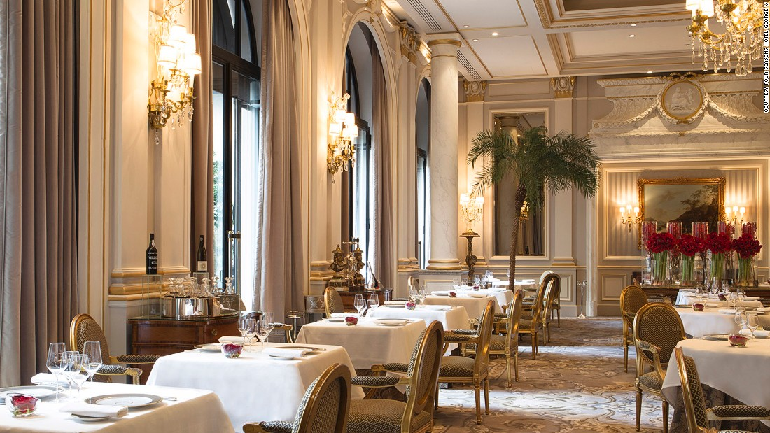 <strong>Le Cinq: </strong>Le Cinq's dining room, located in the Four Seasons Hotel George V,  is decorated in gold and gray and includes priceless furniture from the reign of French kings Louis XIV and XVI.