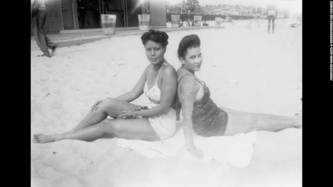 Women sit at the Coney Island beach in 1943.